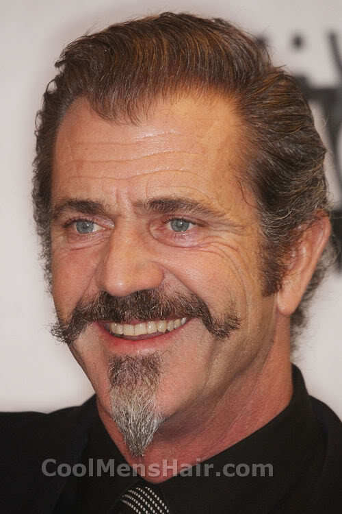 Mel Gibson with mustache and goatee.