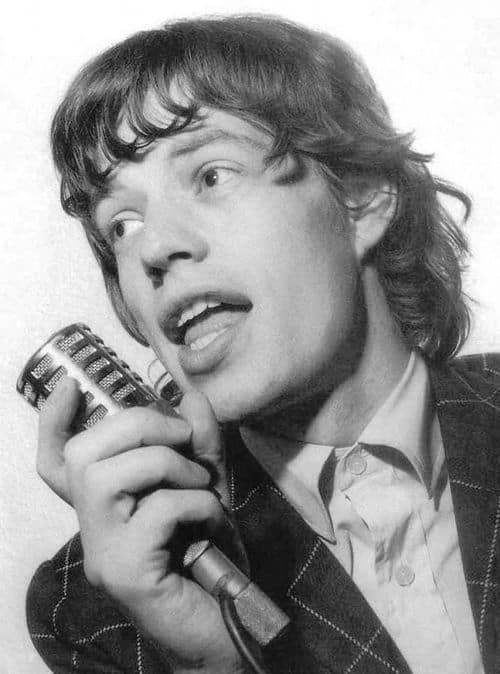 Picture of Mick Jagger hairstyle curly ends.