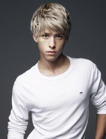 Photo of Mitch Hewer medium length bed head hairstyles.