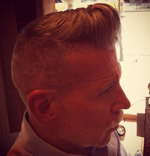 Photo of Nick Wooster pompadour hair.