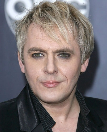 Nick Rhodes messy blond hairstyle.