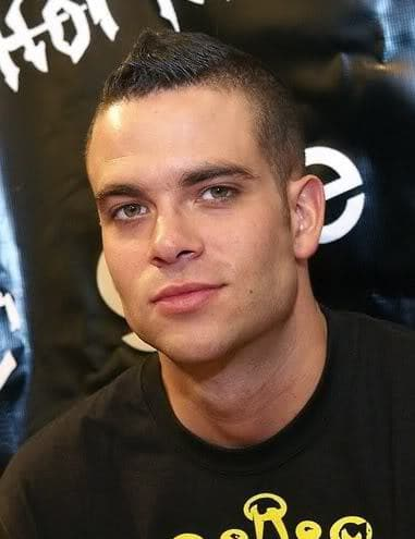 Photo of Mark Salling as Noah 'puck' Puckerman with short mohawk hairstyle.