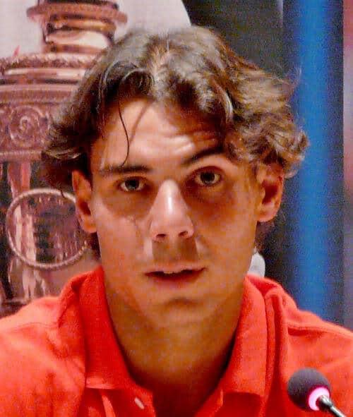 Photo of Rafael Nadal short hair style.
