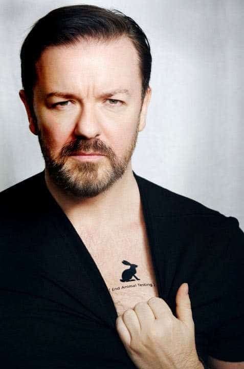 Photo of Ricky Gervais conservative side parted hairstyle.