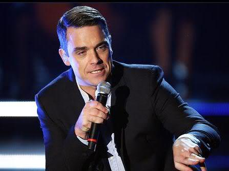 Picture of Robbie Williams conservative hairstyle.