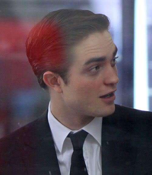 Image of Robert Pattinson slick back hairstyle.