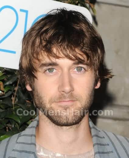 Photo of Ryan Eggold messy shaggy hair.