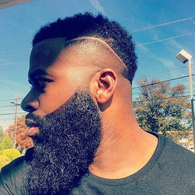 temp fade haircut with part and curls for men