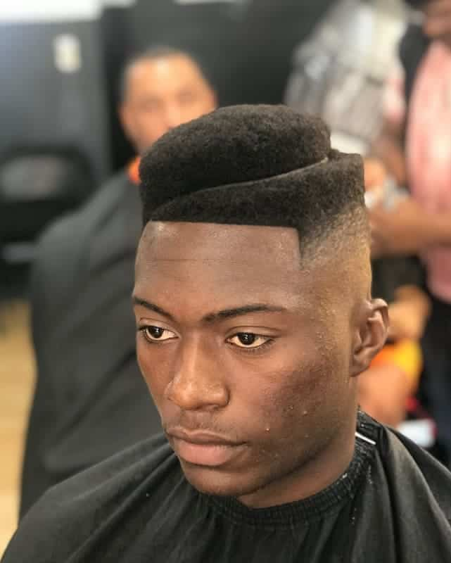 black guy with curly temp fade and part