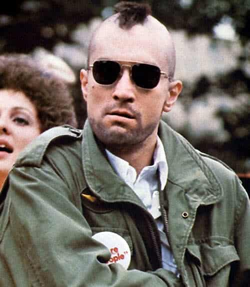 Photo of Travis Bickle with mohawk hair and aviator sunglasses.