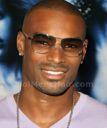 Photo of Tyson Beckford bald look style for black men.