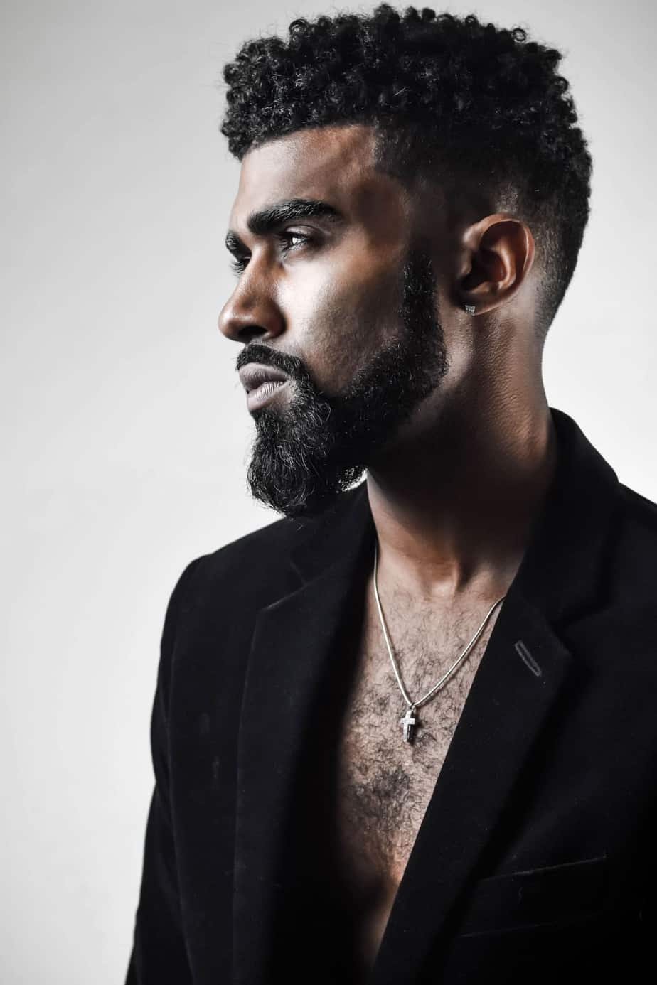black men curly under cut hairstyle