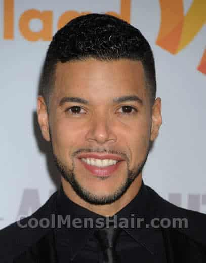 Picture of Wilson Cruz short hair.