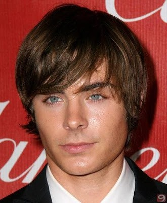 Men's side swept bangs hairstyle from Zac Efron