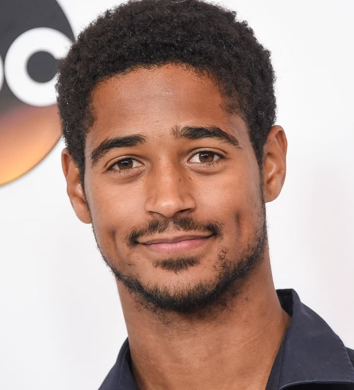 actor with afro curls - Alfred Enoch