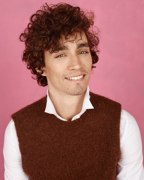 Actor With Curly Brown Hair