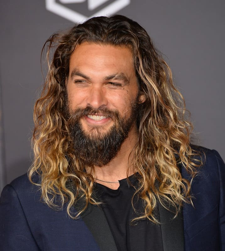 actor with loose curly hair - Jason Momoa