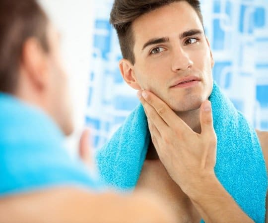 using aftershave on beard
