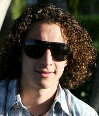 Photo of Andres Guardado long curly hairstyle.
