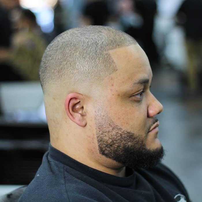 guy with bald fade and beard