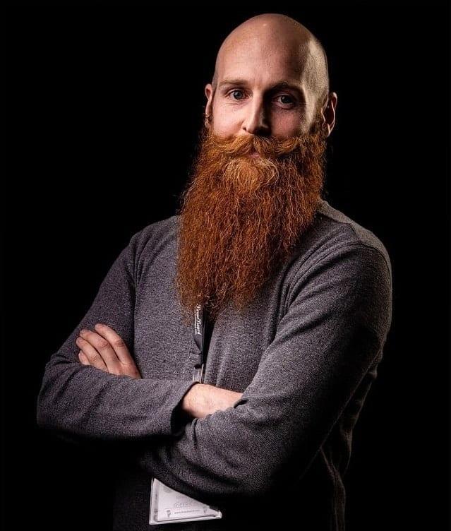 bald men with long ginger beard