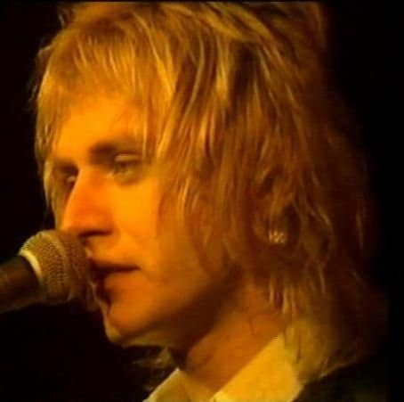 Photo of Benjamin Orr hair with long sides.