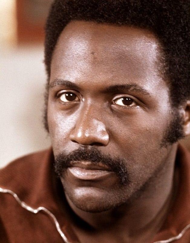 black men with long mustache