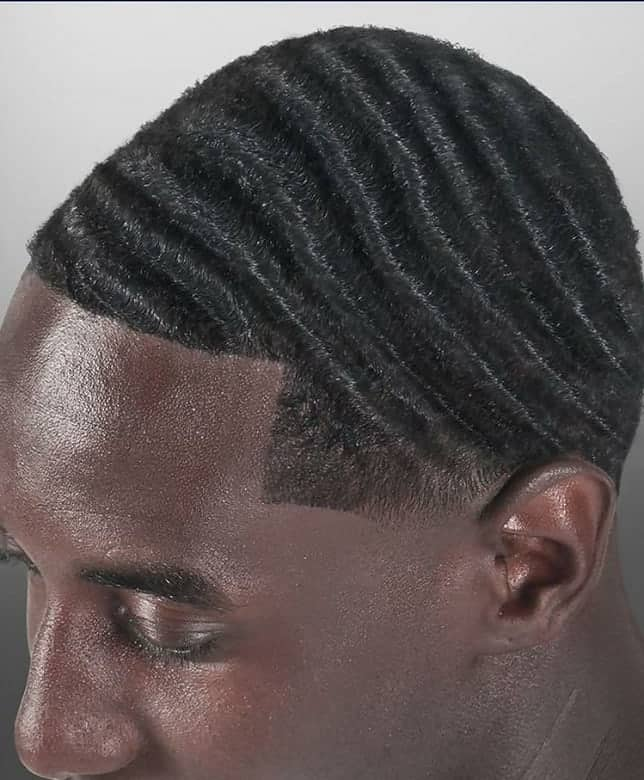 black man with 360 waves hairstyle