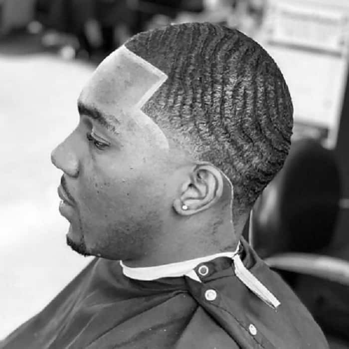 black men temple fade haircut with waves
