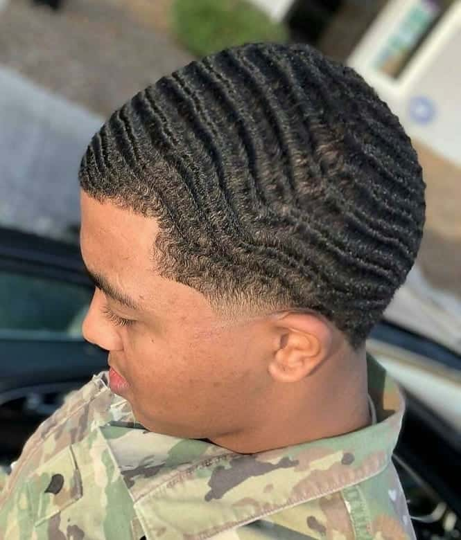 black guy with 360 waves hairstyle