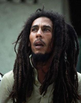 Bob Marley with his dreadlocks style