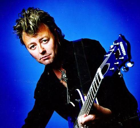 Picture of Brian Setzer classic rockabilly hair.