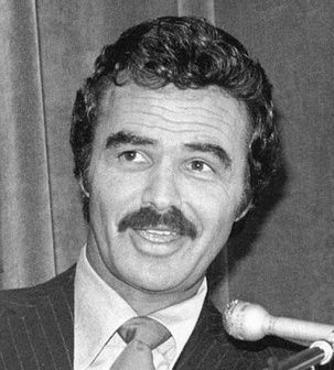 Image of Burt Reynolds curly hair.