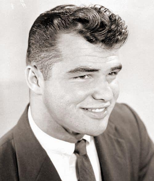 Photo of Burt Reynolds pompadour hairstyle.