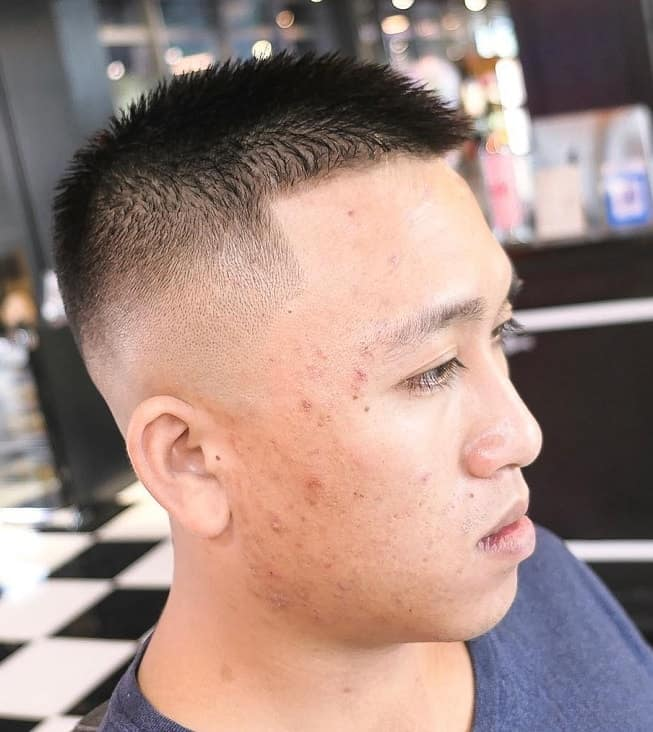 Asian guy with butch cut