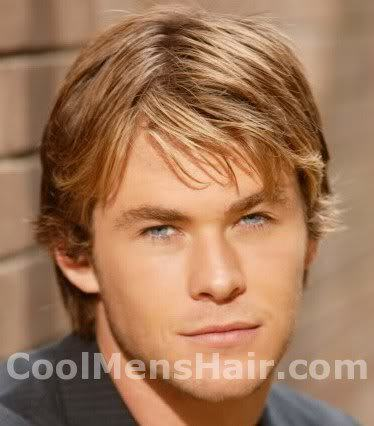 Photo of Chris Hemsworth shaggy hair.