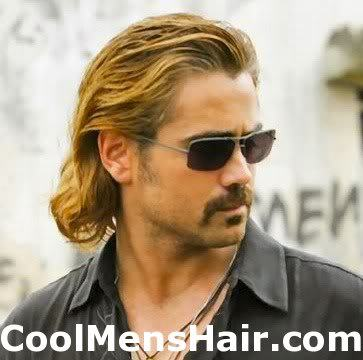 Photo of Colin Farrell swept back hairstyle.