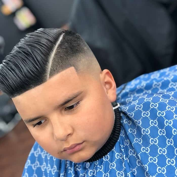little boy with comb over haircut