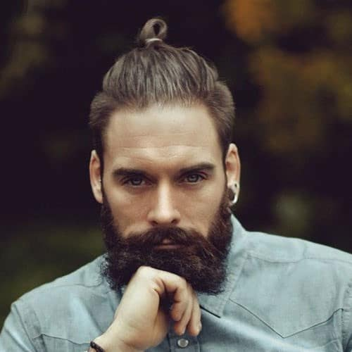 man with a top knot bun