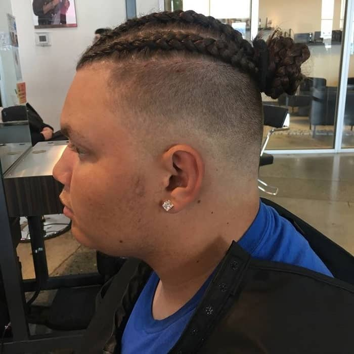 cornrow man bun with shaved sides