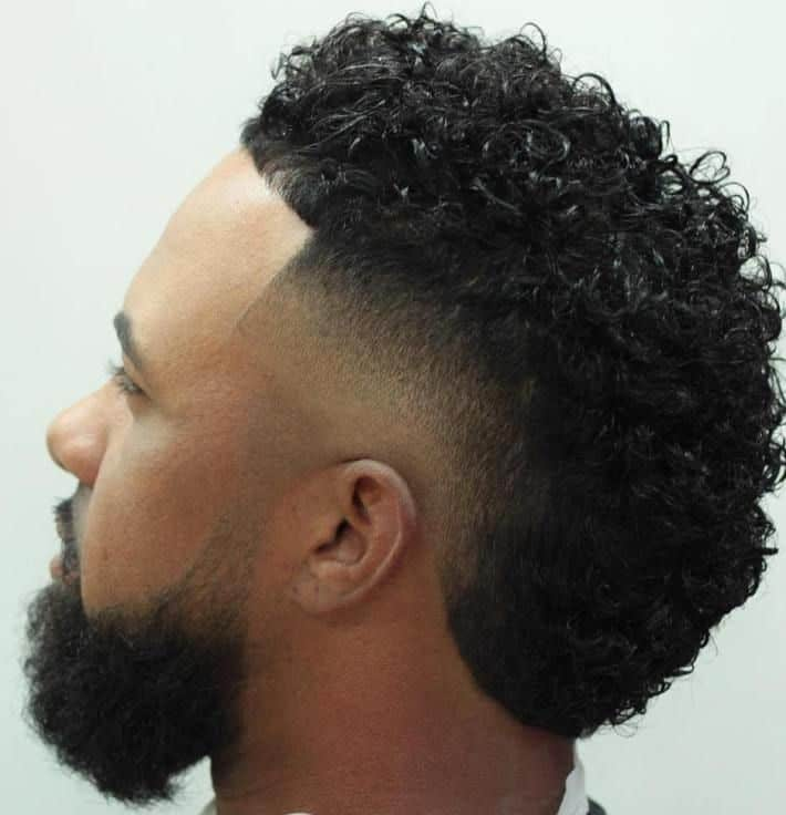 curly faux hawk with low fade
