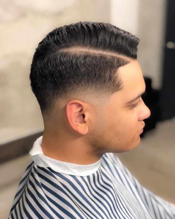 guy with curly comb over haircut