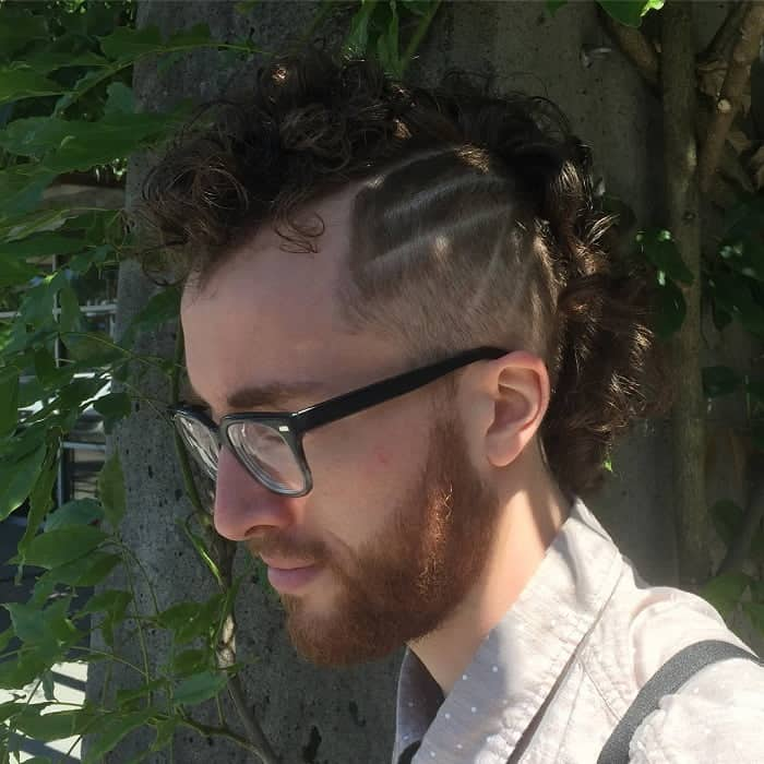 curly hair fade with design