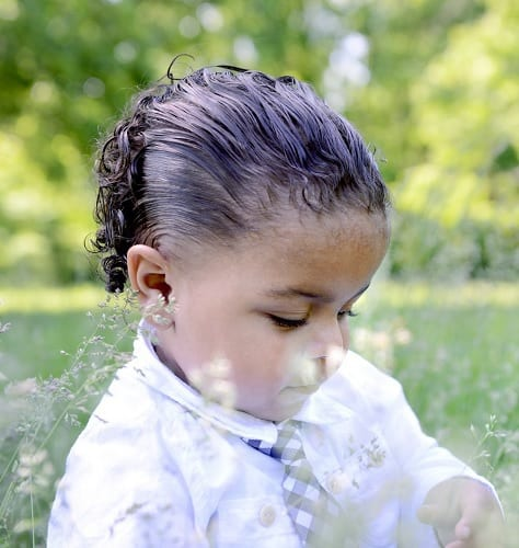 slicked back curly hairstyle for little boy