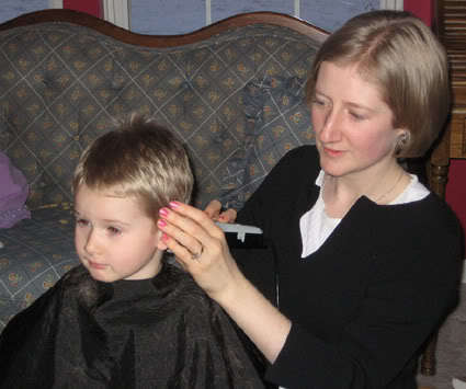 Cutting boy's hair.