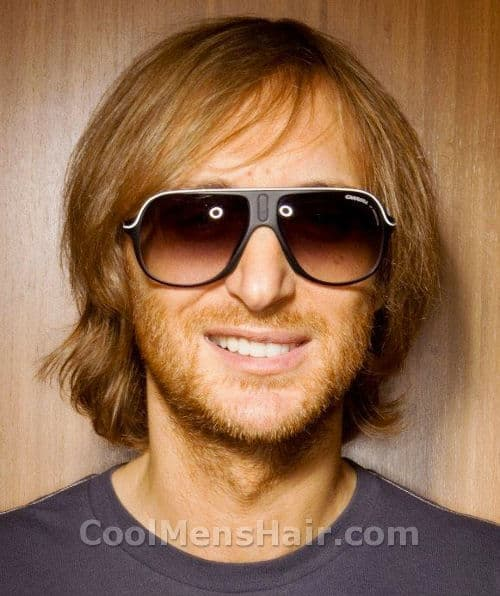 Photo of David Guetta hairstyle.