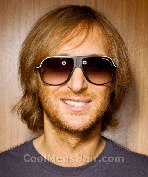 Photo of David Guetta hairstyle.