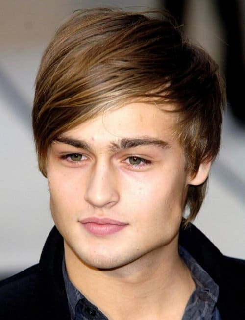 Photo of Douglas Booth hairstyle with bangs.
