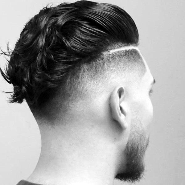 Skin Fade Haircut. Trim the hair of the sides closer to the skin. Arrange the top hair so carefully to make a ducktail effect.