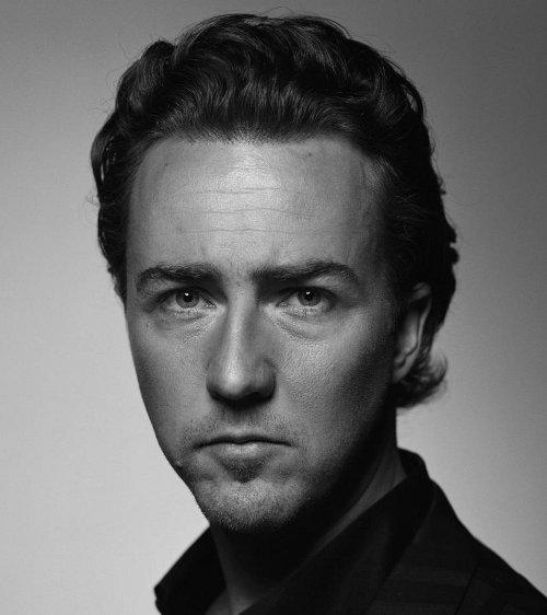 Photo of Edward Norton combed back hair.